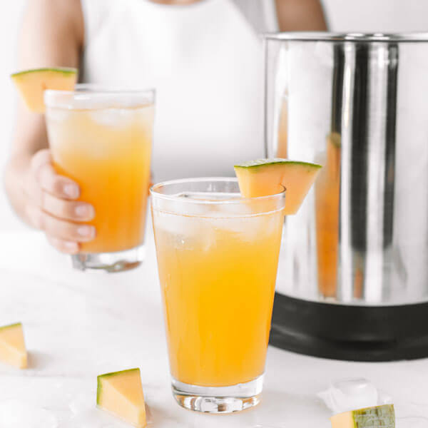 glasses of Cantaloupe Agua Fresca made with an almond cow