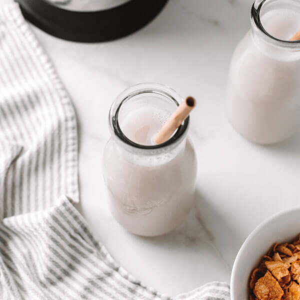 vegan homemade Cereal Milk in a glass with a straw