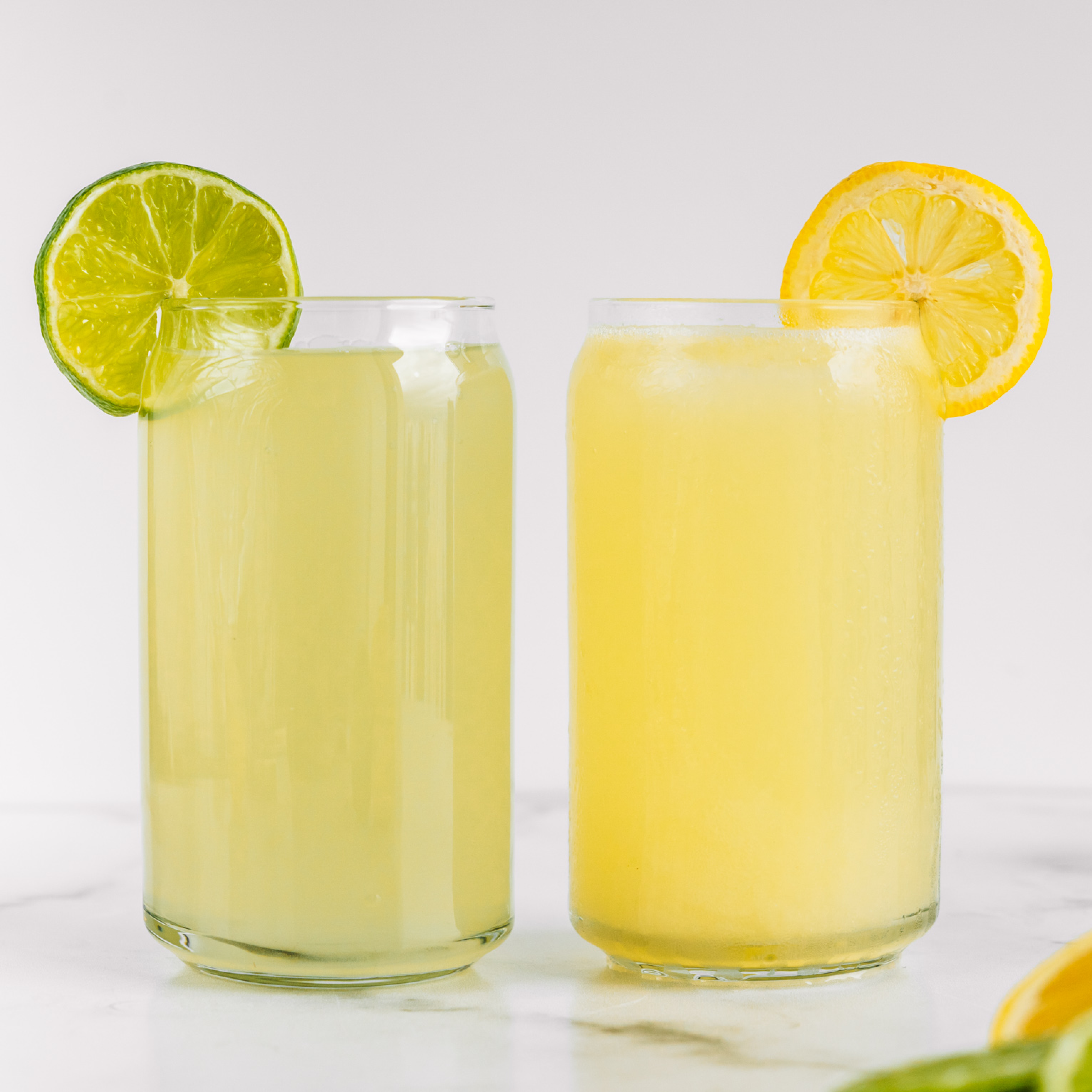 a glass of limeade and lemonade made in the almond cow