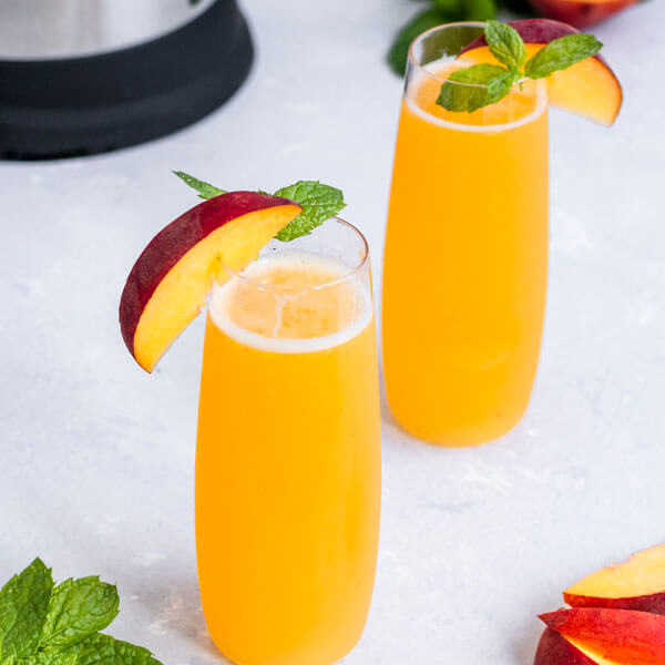 Peach Bellinis made with an almond cow