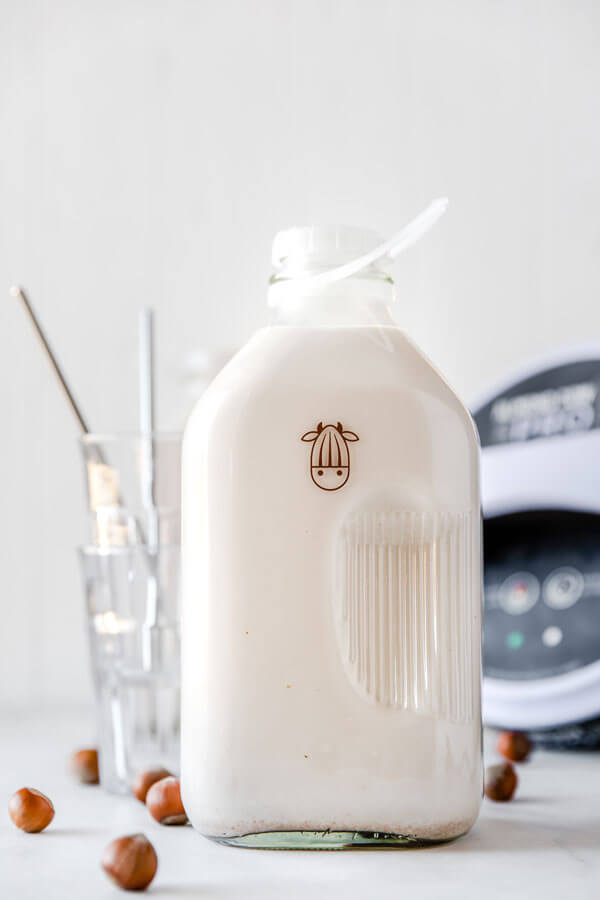 hazelnut milk made with the almond cow pro in an almond cow jug