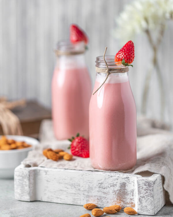 Strawberry Red Beet Almond Milk in two glasses