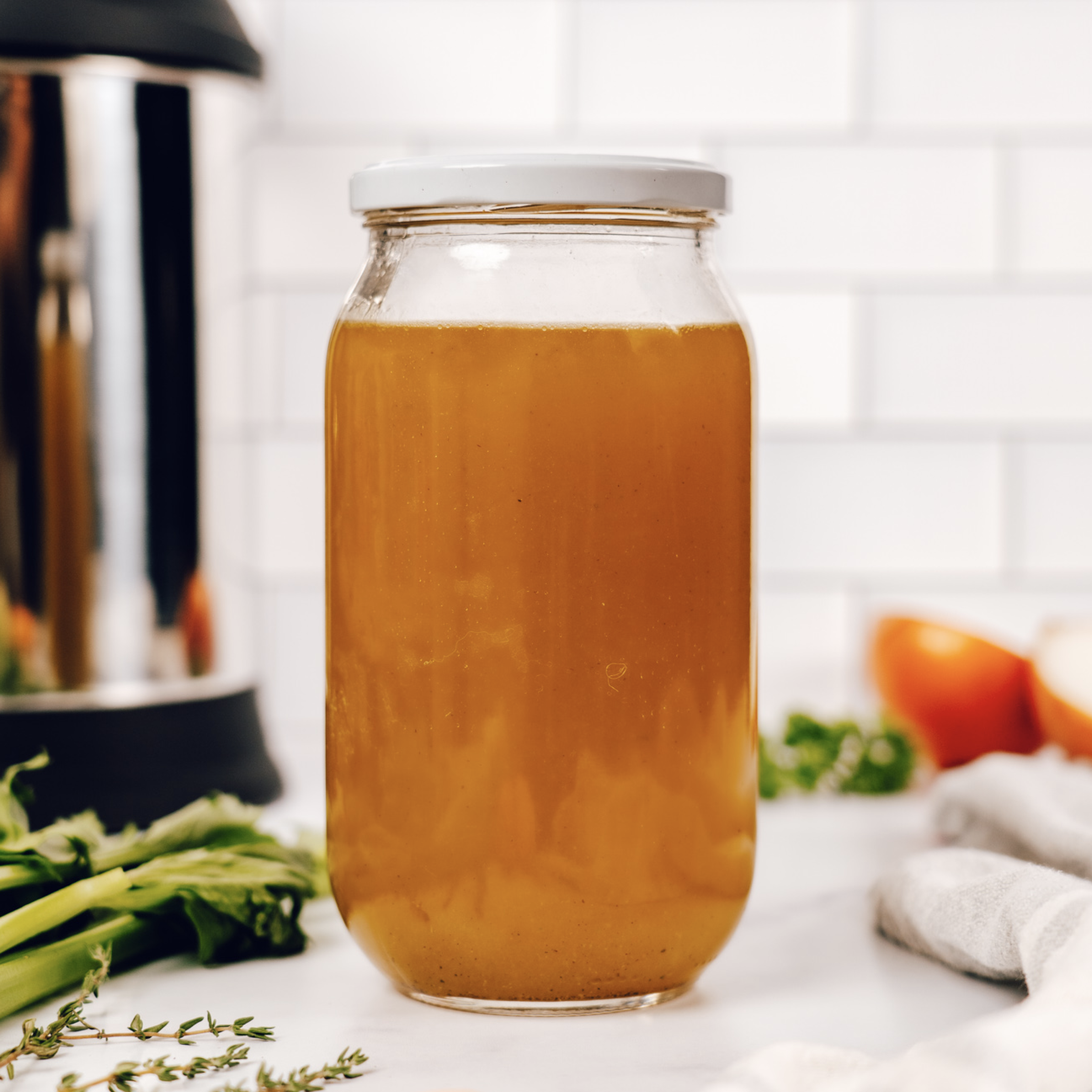 glass container of vegan vegetable broth