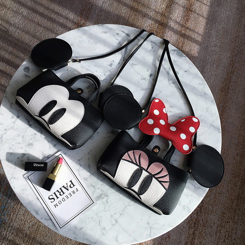 A new Korean version of the mini-children's pocket bag, Mickey Minnie, slanting the small cross-bag bag P0041