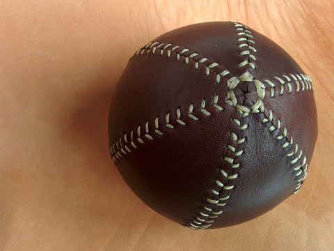 Leather bouncing ball, decorative leather ball, 10 cm diam, Spanish chocolat oiled leather.
