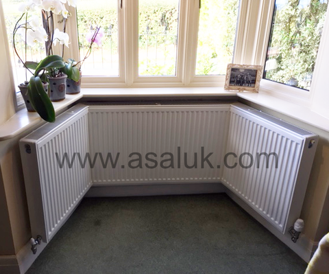 Angled Double Bay Window radiator fitted with grills