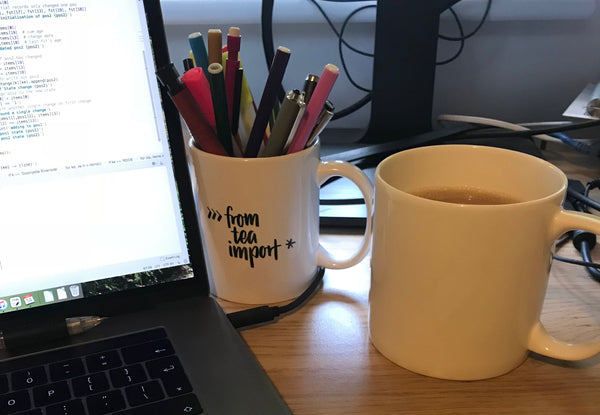 """from tea import *"" Python mug used as a penholder"