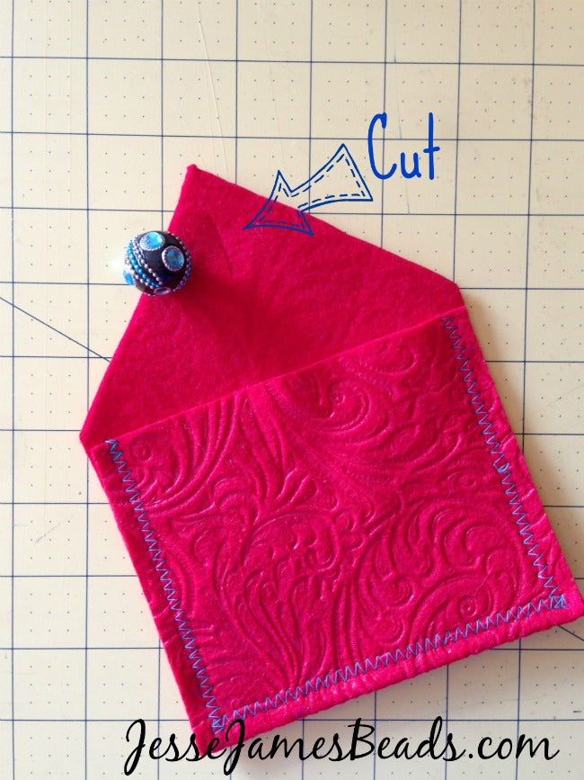 Cut a slit in the pouch for the bead button to go through