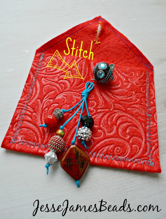 Stitch and knot the beads on the tassel