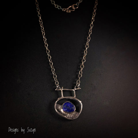 Small Freeform silver pendant with rose cut lapis
