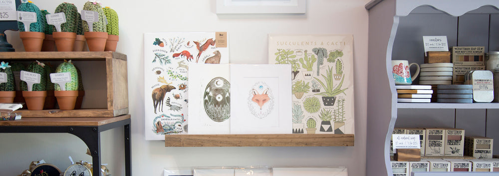 Image of gift shop featuring art prints and handmade goods