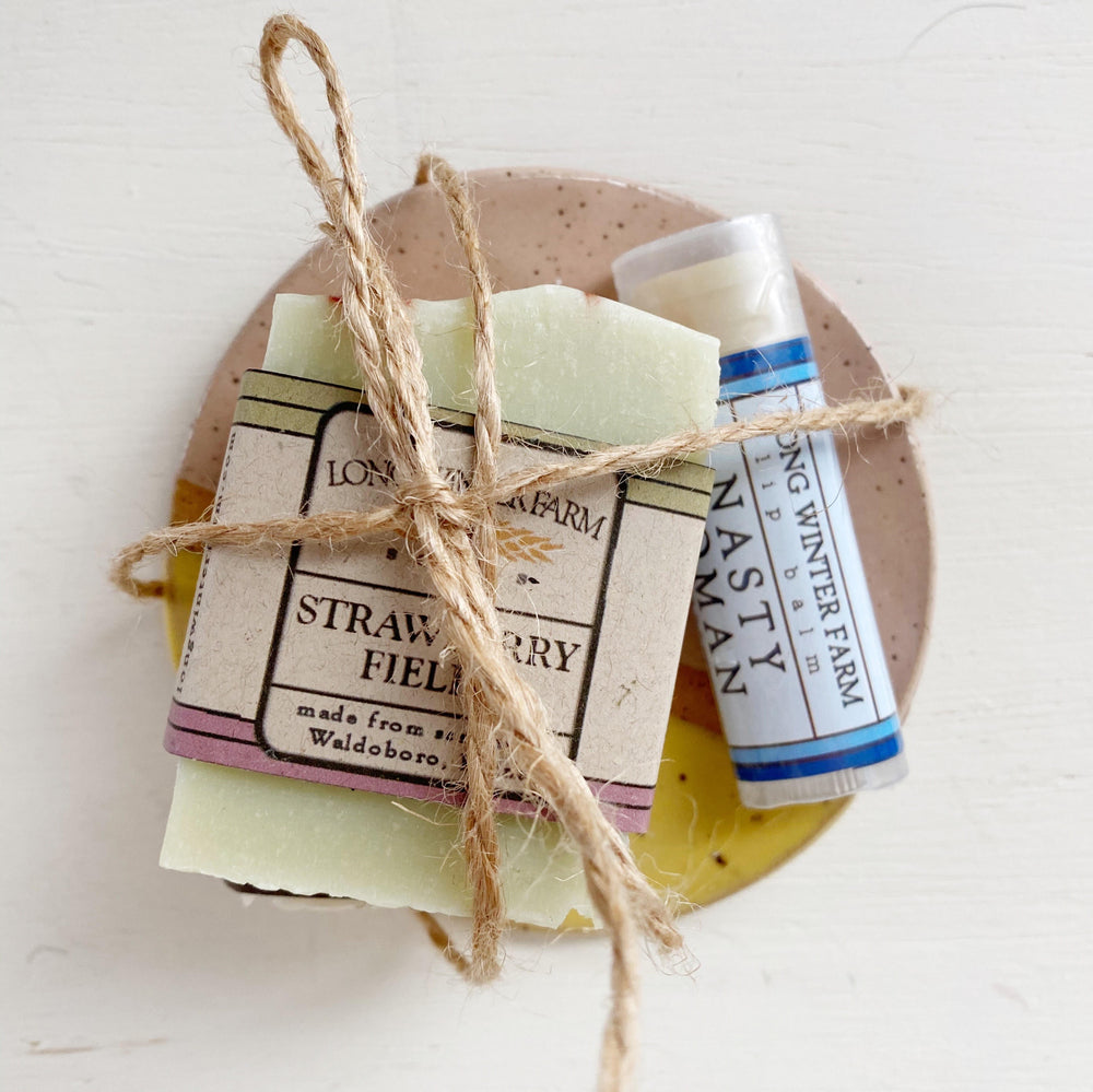 Gift set featuring soap, lip balm and ceramic dish