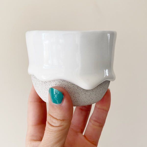 drippy ceramic teacup in white