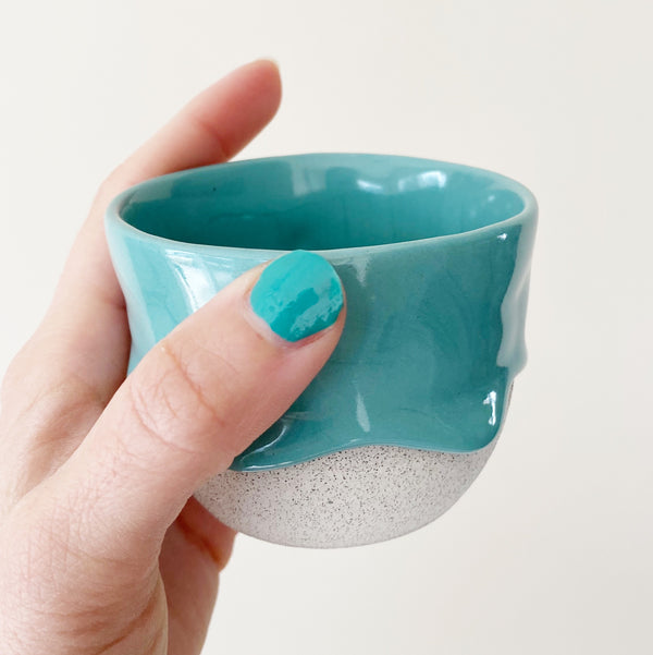 drippy ceramic tea cup in sea green