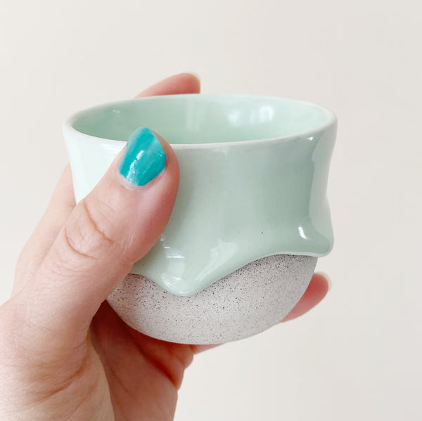 drippy ceramic tea cup in mint color