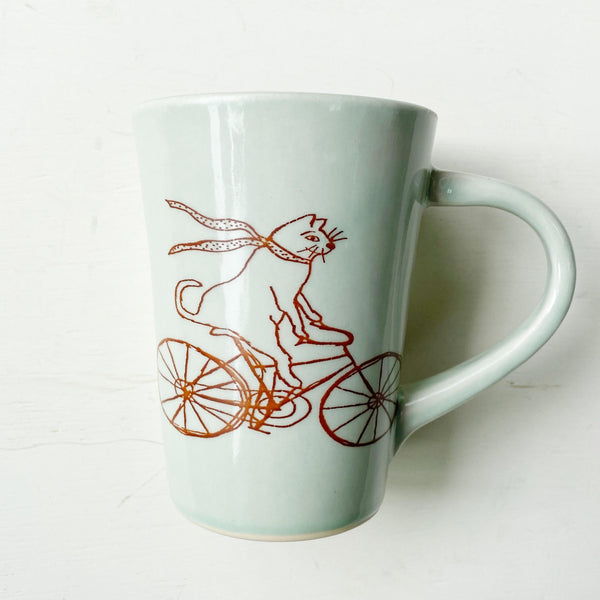 Biking Cat Ceramic Mug