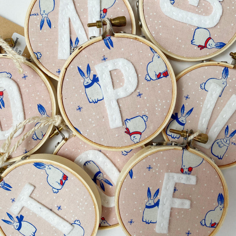 Initial Christmas Ornament - Pink Snow Bunnies fabric with whilte letter