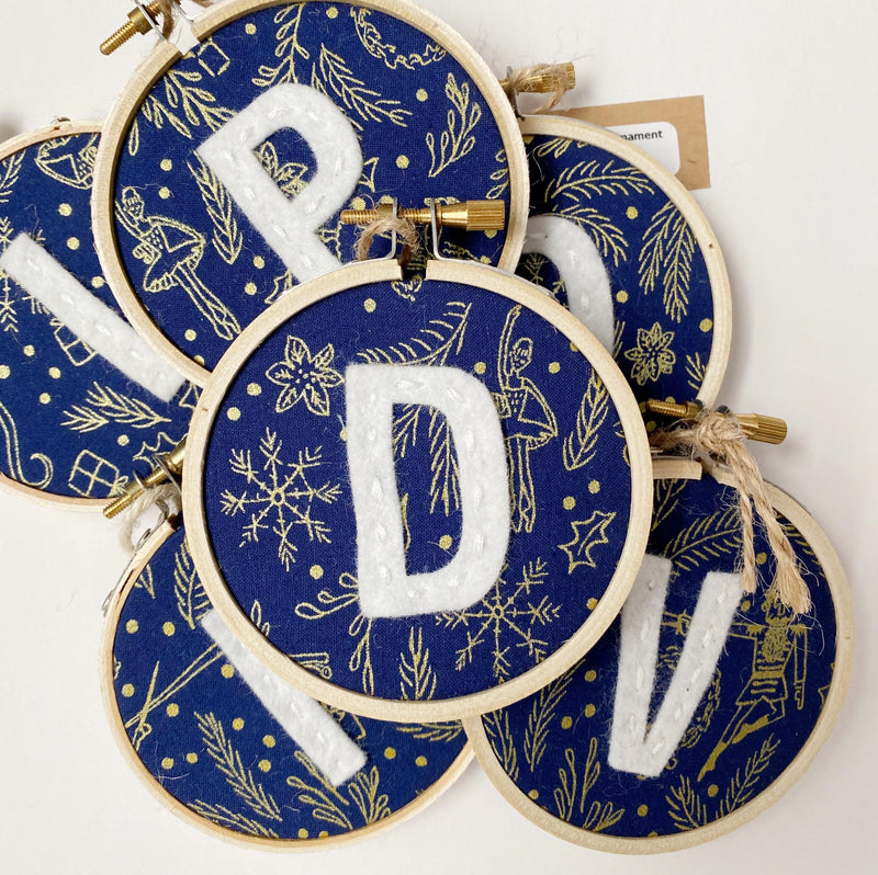 Initial Christmas Ornament - Nutcracker Blue fabric with white letter