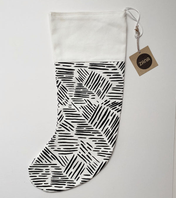 Christmas stocking with black dashes