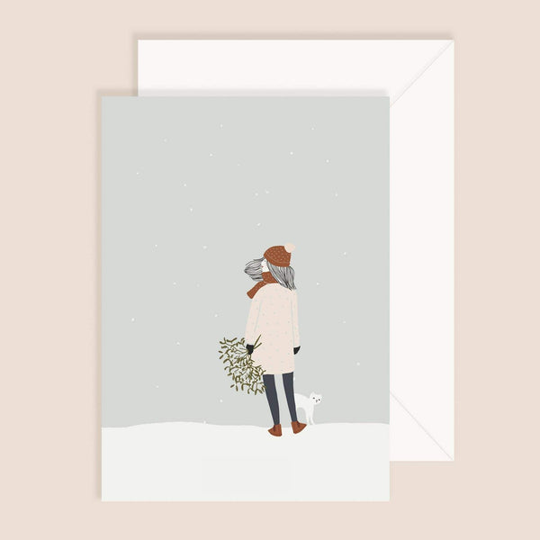 Girl with cat in winter greeting card