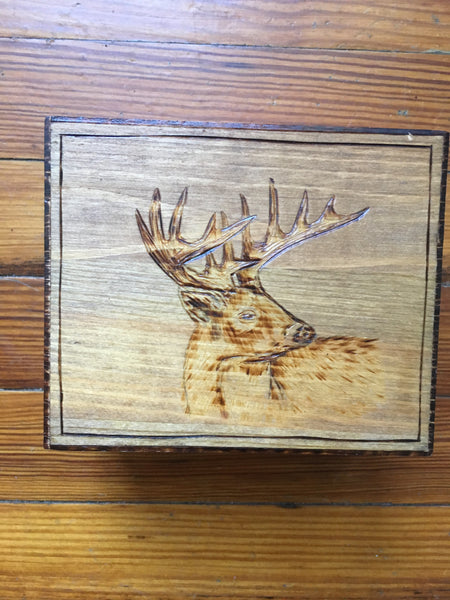 Deer Clan wood box, looking right