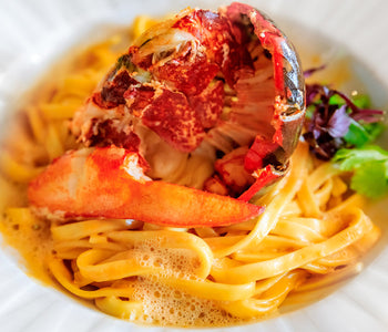 Grilled Lobster Tails Fra Diablo served with Fettuccine and Sabatino White Truffles