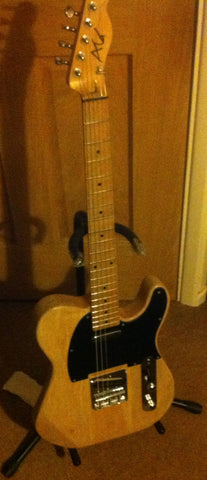 Maple neck through with ash wings... my baby