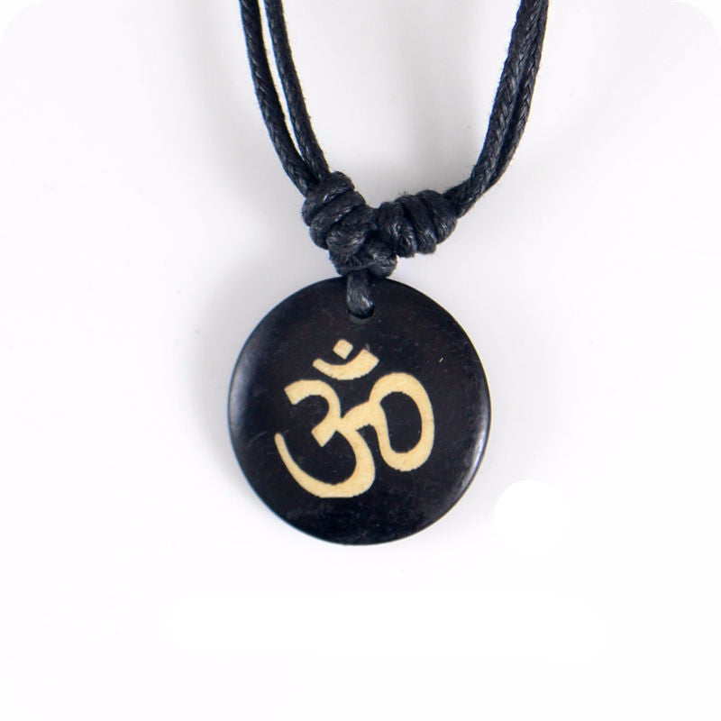 OM Ohm Yoga Carved Pendant