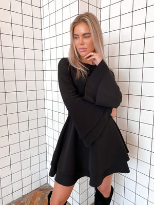 Black Dress With Double Sleeves and Skirt