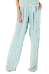 Denim trousers with circles attached