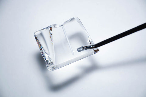 Expose the green and change your game. The clear head of the Ice Cube Putter.