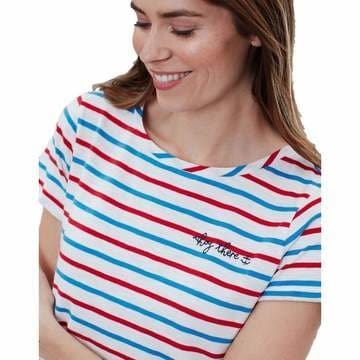 a woman in striped shirt talking on a cell phone