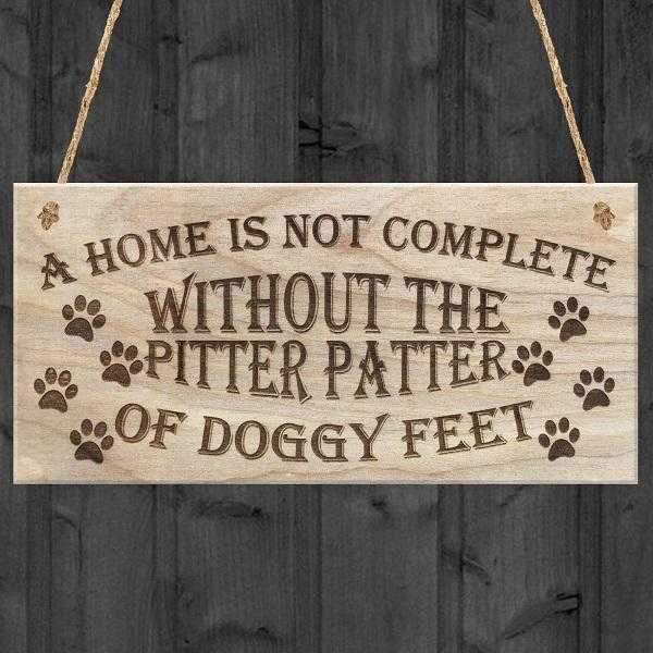 A home is not complete without the pitter patter of Doggy Feet Hanging Sign-DoggyTopia