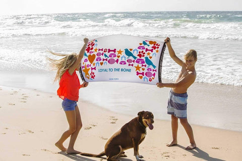 "Image of Growl Towels ""Loyal to the Bone"" Beach Towel-DoggyTopia"