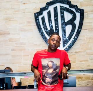 q-money-signs-with-warner-bros