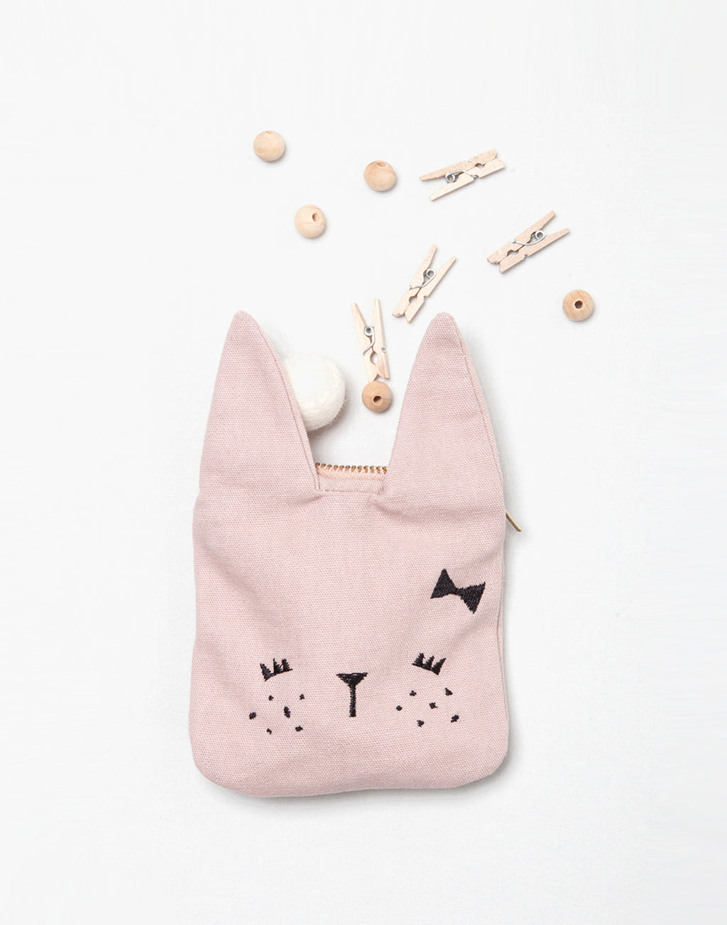 Fabelab   Small organic cotton coin pouch with bunny ears for little treasures.   Size: 10 x 14,5cm.  Color: pink, black.  Composition: 100% GOTS certified organic cotton, nickel free zipper.   Design from Denmark.