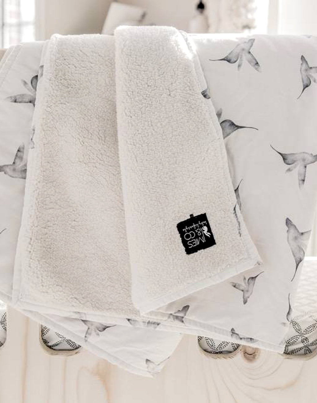 Mies & Co   Soft teddy blanket with all over dots print! Ideal for the crib or on the gun in the stroller/pram.   Size: 70 x 100cm.  Color: off white, dark grey.  Composition: 100% cotton, layered with 100% polyester teddy.   Dutch design, made in Europe.
