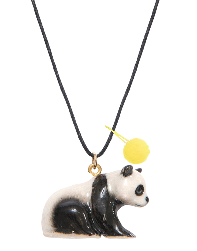 A Mini Penny   A porcelain Panda hanging on a soft cotton black cord necklace.