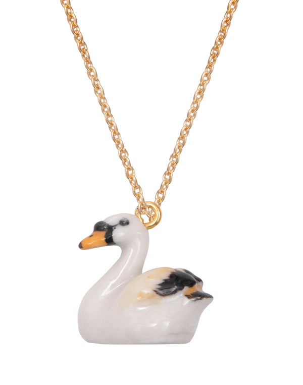 A Mini Penny   Cute tiny porcelain swan hanging on a 18k gold plated chain.