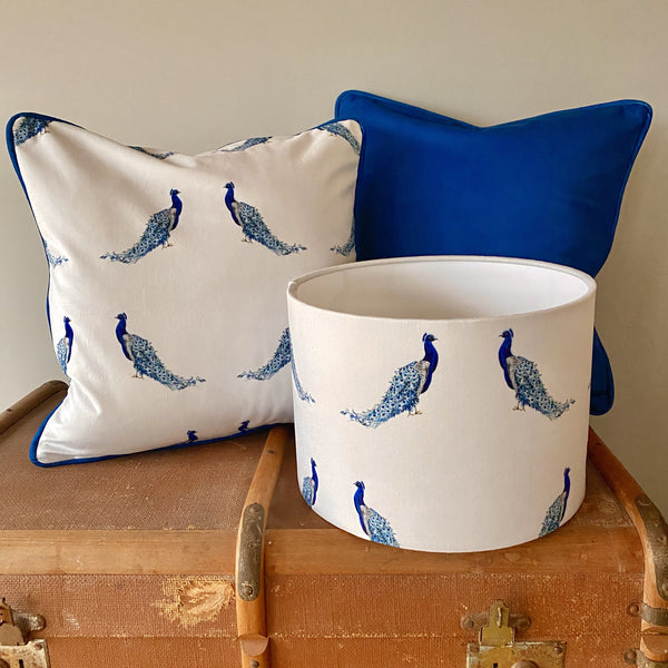 Albert Peacock Fabrics by the Metre - on Silver Grey Background