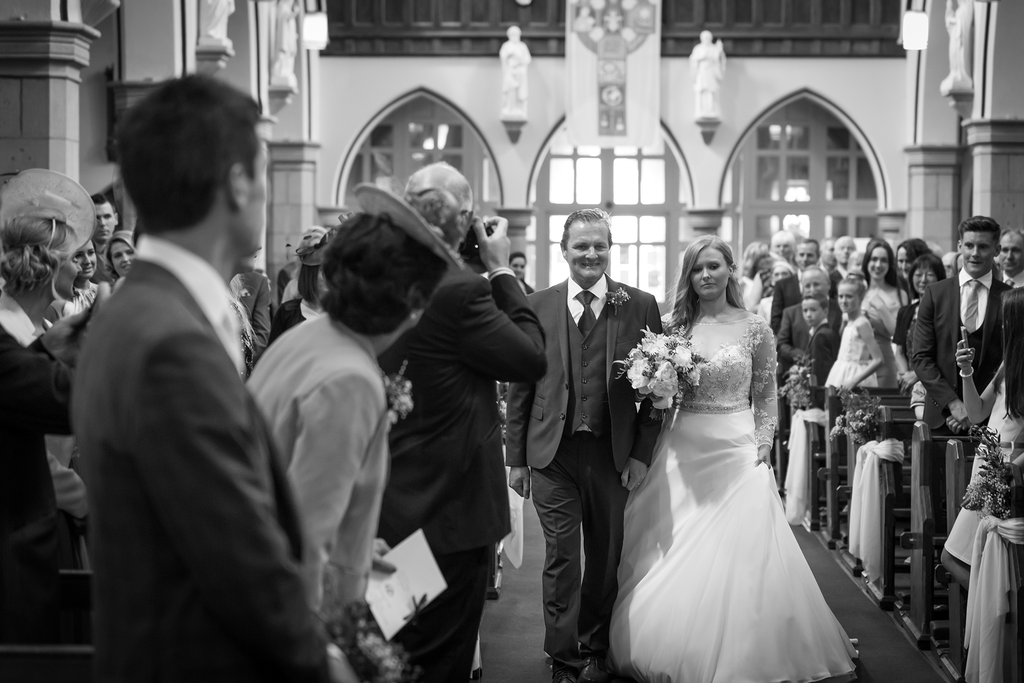 Bride happy walking up the aisle wedding photographer galway