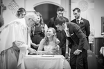 Wedding photography Laughing with priest