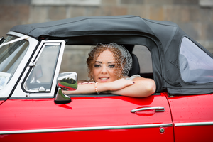Original wedding photographer Bride in a sports car