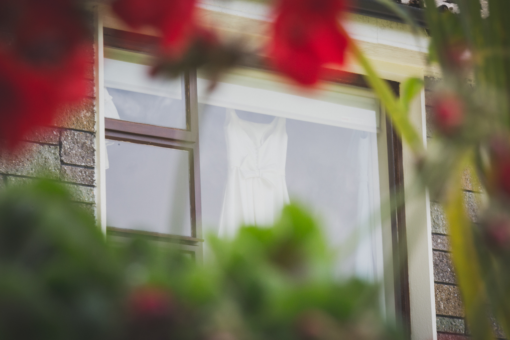 Wedding dress hanging up at window in Roscommon Galway wedding photography