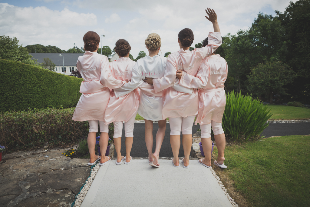 Bridesmaids in robes waving and having fun Wedding Photographer Galway Roscommon and Loughrea