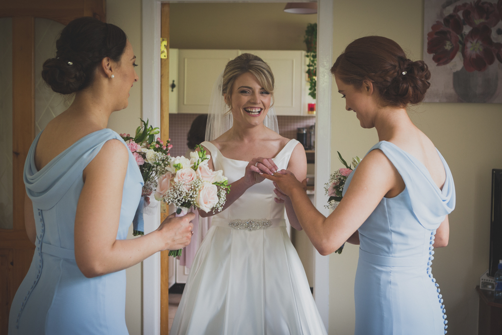 Laughing Bride and Bridesmaids before wedding prep galway/Roscommon wedding photographer