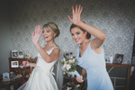 Bride And bridesmaid happy waving out the window Galway wedding photographer