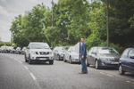Fun relaxed Wedding photography Wedding sign groomsman stopping traffic Galway Roscommon.