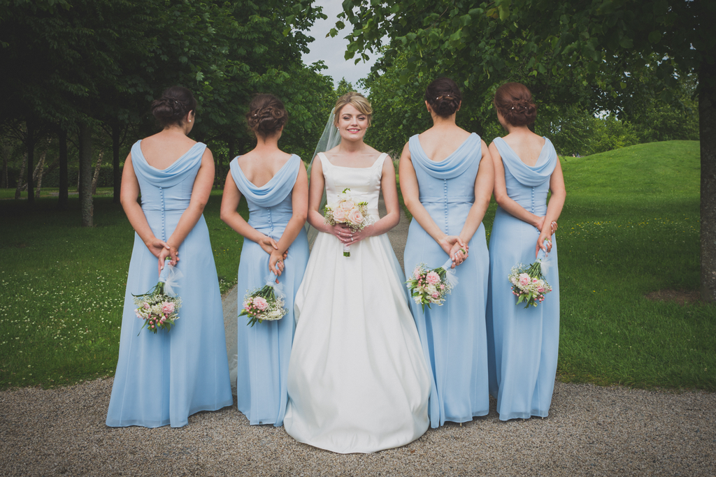 Bride and bridesmaid photography blue dress flowers roscommon castle galway wedding