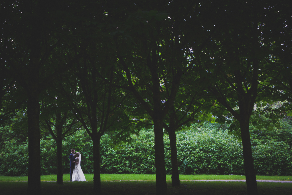 Bride and groom under the trees Roscommon castle Galway Wedding photography